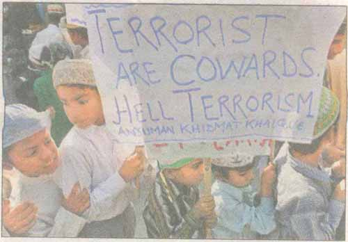 Muslim boys hold a placard during a protest in Siliguri against the terrorist attacks in Mumbai. Tribute to all those who lost their lives for our great nation.