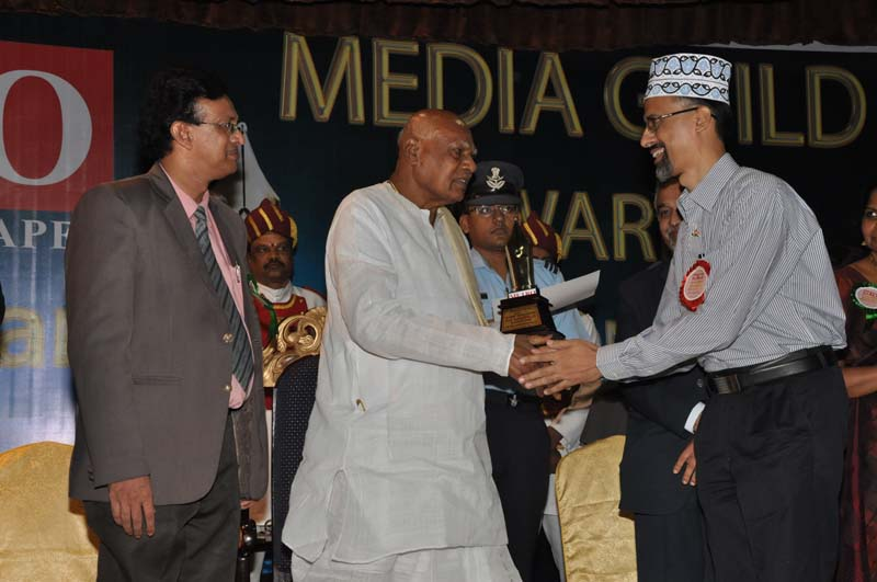 Receiving Media Guild Award From Dr. K. Rosaiah, H.E. The Governor of Tamil Nadu.